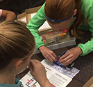 Photo showing students constructing a circuit